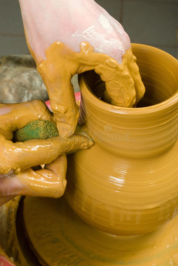 Download Hands Of A Potter, Creating An Earthen Jar Of Yellow Clay Stock Photo - Image: 33677838