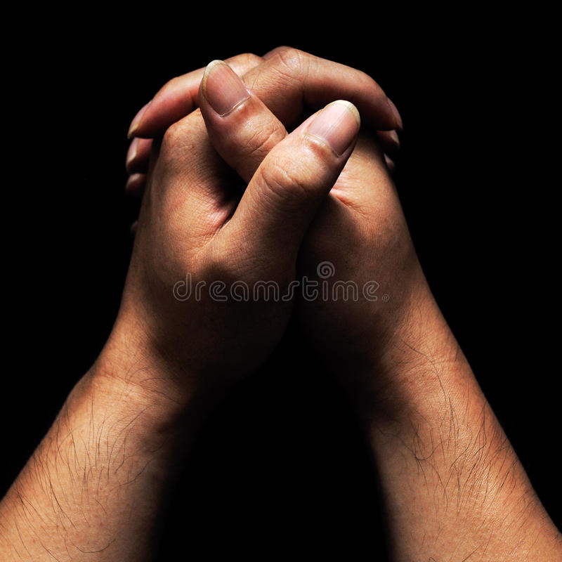 Hands in prayer stock photography