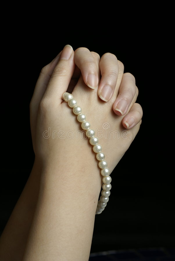 Hands In Prayer With Pearls Stock Photography