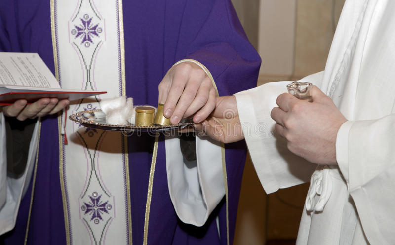 Hands of priest at benediction of oil. By catholic liturgy royalty free stock photos