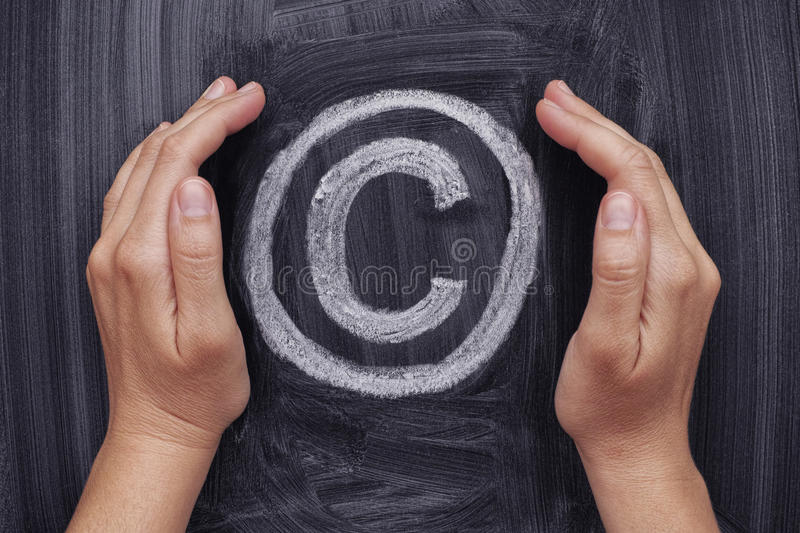 Hands protecting copyright symbol stock images