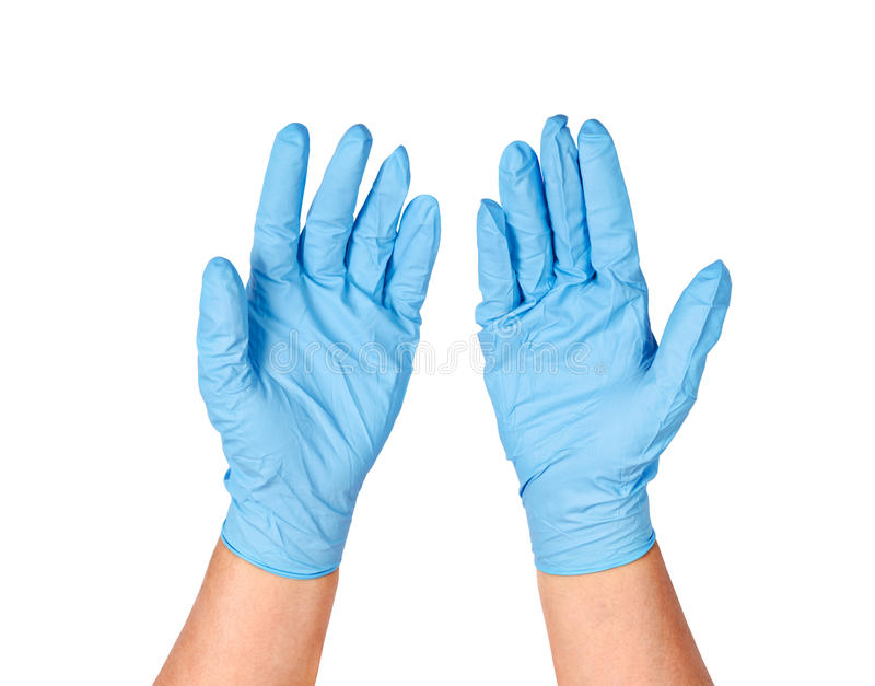 Hands putting on protective blue gloves. stock photo