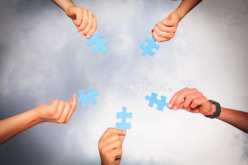 Hands With Puzzle Pieces stock images