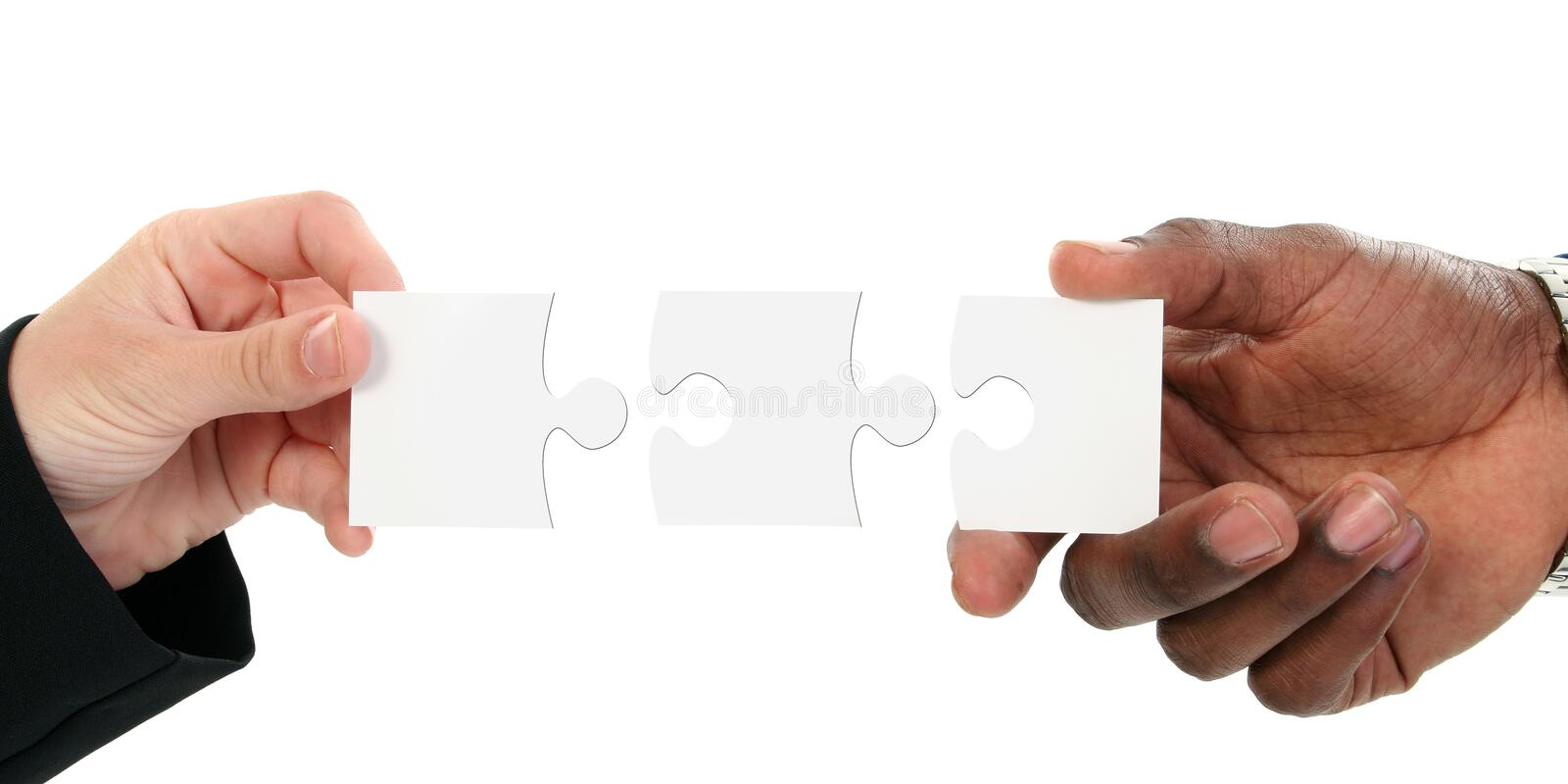 Hands And Puzzle Pieces Isolated On White royalty free stock photography