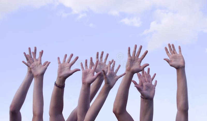 Hands Raised In Air Against Sky Stock Image