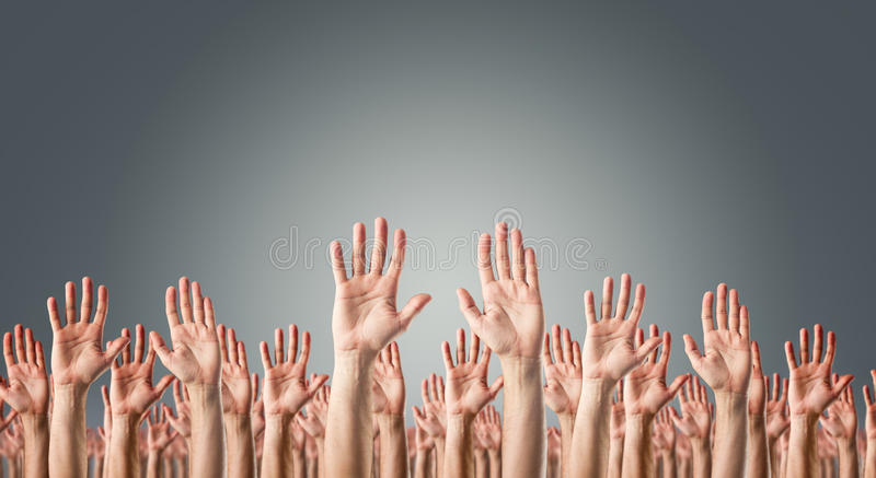 Hands raised in the air royalty free stock images