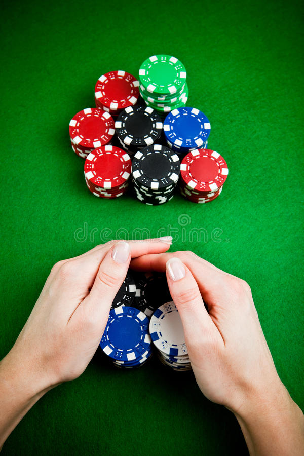 Hands rakes up gambling chips stock photography