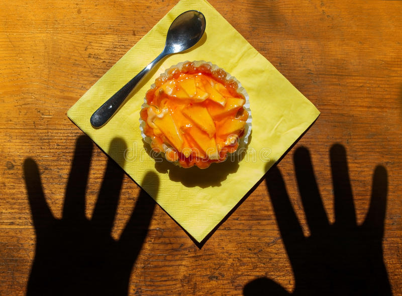 Hands reaching for dessert royalty free stock photography
