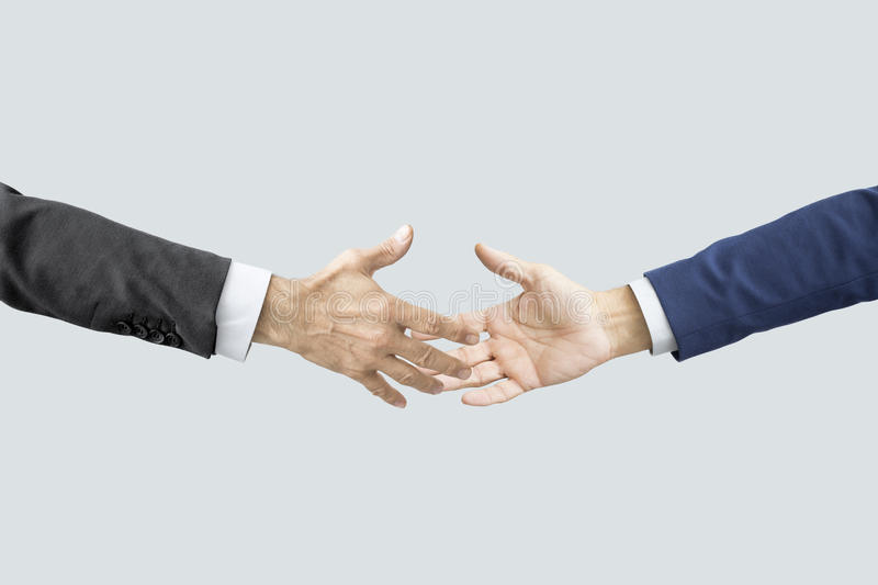 Hands reaching each other. People hands reaching each other royalty free stock photography