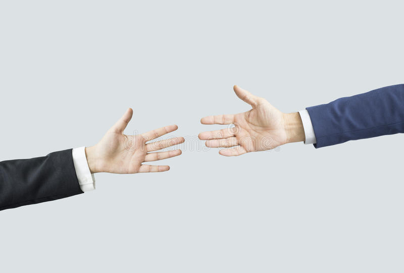 Hands reaching each other. People hands reaching each other royalty free stock photo