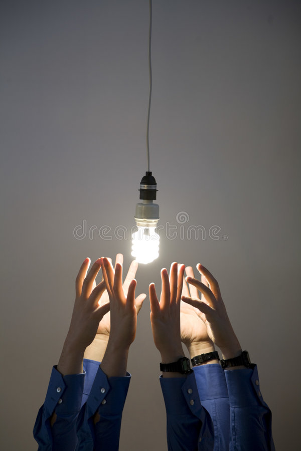 Download Hands Reaching For Light Bulb Stock Image - Image: 5112683