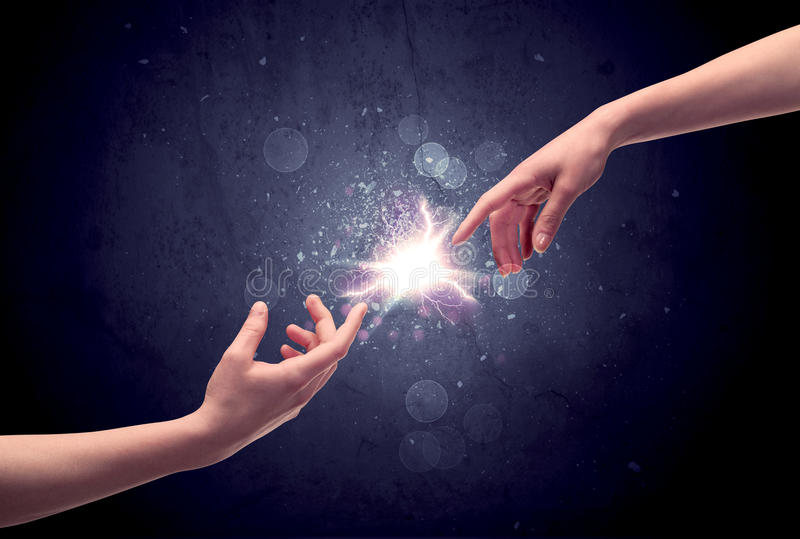 Hands reaching to light a spark royalty free stock photos