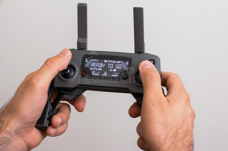 Hands with remote controller of drone outside. Man using RC for flying by drone royalty free stock photo
