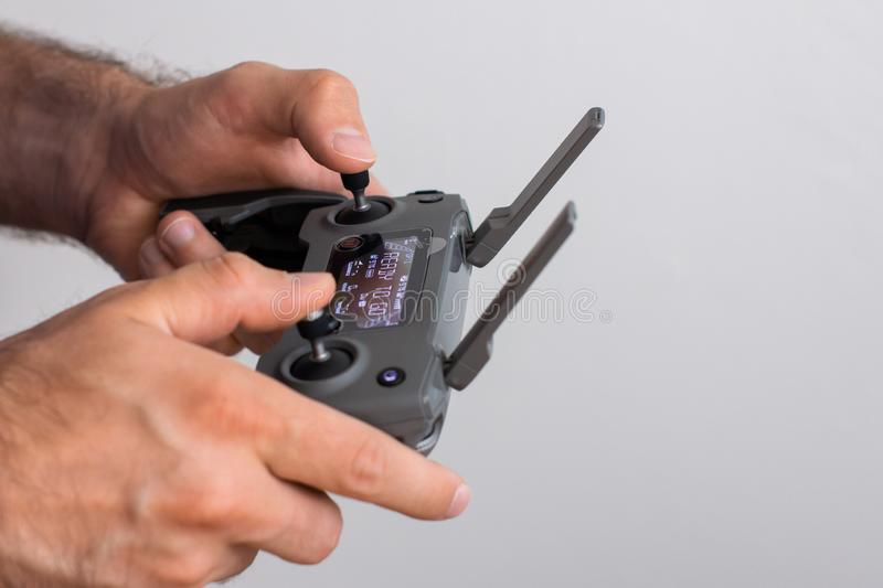 Hands with remote controller of drone outside. Man using RC for flying by drone stock photos