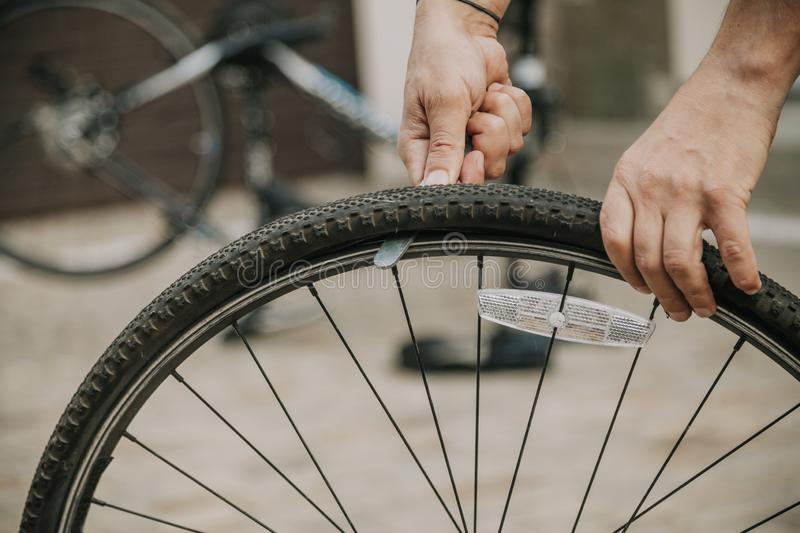 Dismantling modern bicycle wheel tire royalty free stock photo