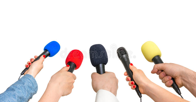 Hands of reporters with many microphones royalty free stock photography