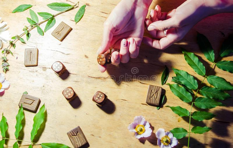 Hands with rings, runes and mint stock photos