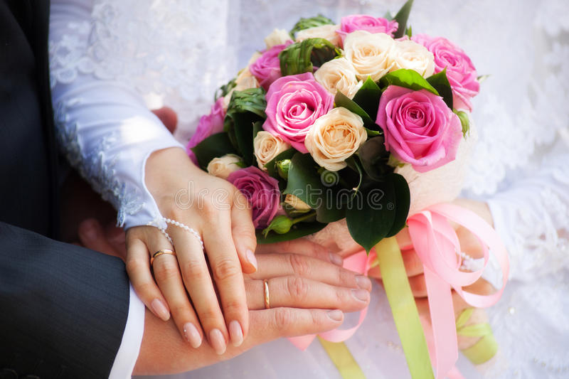 Hands. Rings and wedding bouquet royalty free stock photos