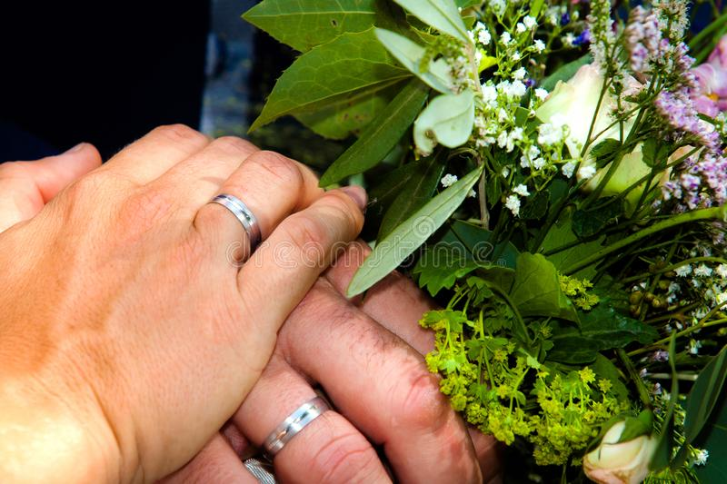Wedding bouquet with couples and rings stock image