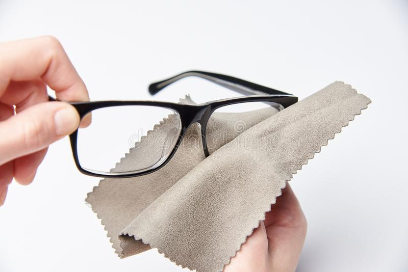 The hands are rubbing the glasses. For a view with a napkin royalty free stock images
