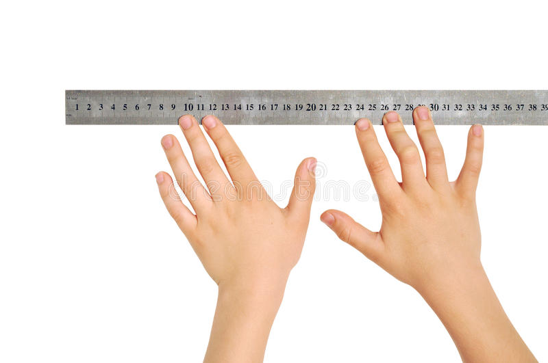 Hands with a ruler. Two hands with a ruler, isolated, clipping path royalty free stock images