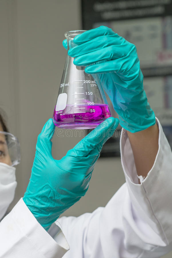 Download Hands In Safety Glove Holding Test Glass With Chemical Inside Stock Image - Image of glassware, female: 40131675