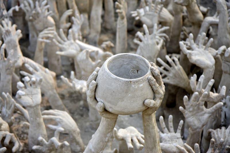 Hands sculpture at Wat Rong Khun temple, Thailand royalty free stock photos