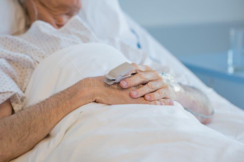 Hands of senior patient stock photo