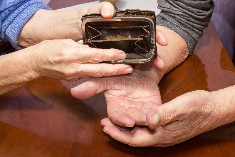 The hands of senior woman with open pocket royalty free stock image