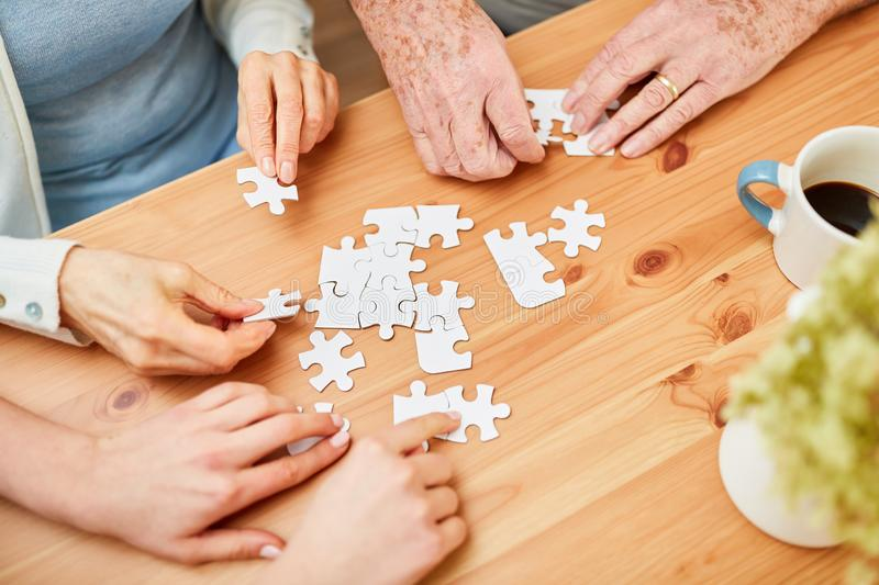 Hands of seniors and young people stock images