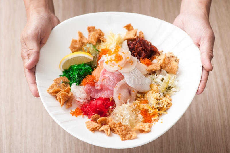 Download Hands Serving A Plate Of Chinese Delicacy Stock Image - Image: 28742773