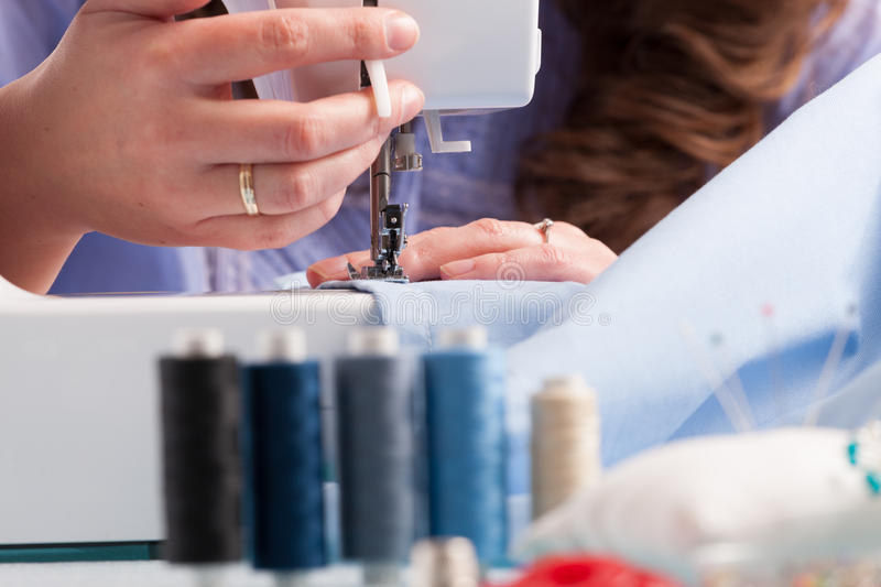 Download Hands On Sewing Machine With Reels Of Colour Threads And Sewing Stock Image - Image: 30555969