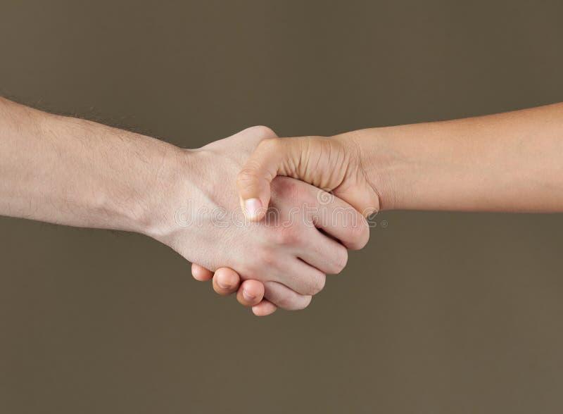 Hands shake closeup. Agreement or achievement concept. Closing a deal handshake stock photos