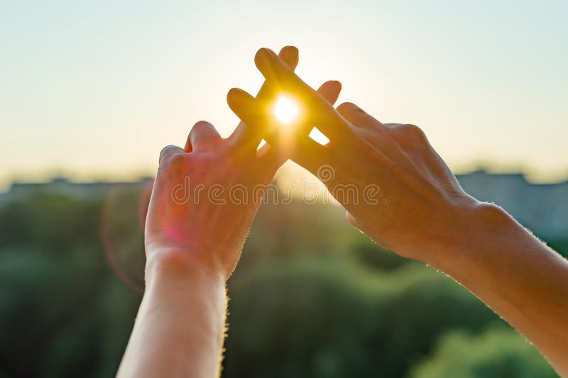 Hands show gesture symbol hashtag is viral, web, social media, network. Background is sunny urban sunset, concept for marketing, t royalty free stock photography