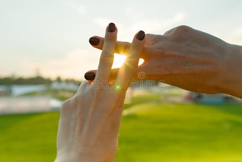 Hands show gesture symbol hashtag is viral, web, social media, network. Background is sunny urban sunset, concept for marketing, t stock photos