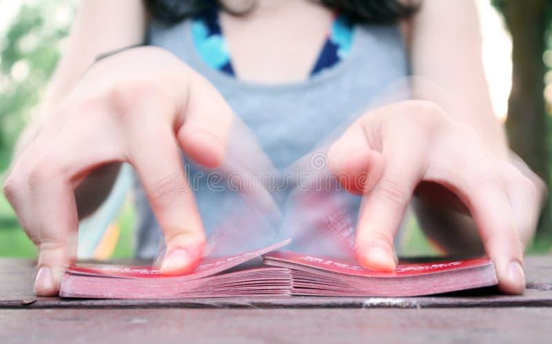 Hands shuffling a deck of cards outdoor stock photos