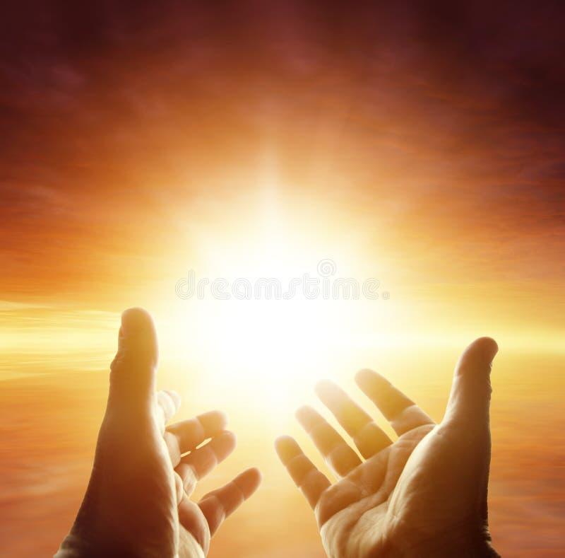 Hands in sky stock image