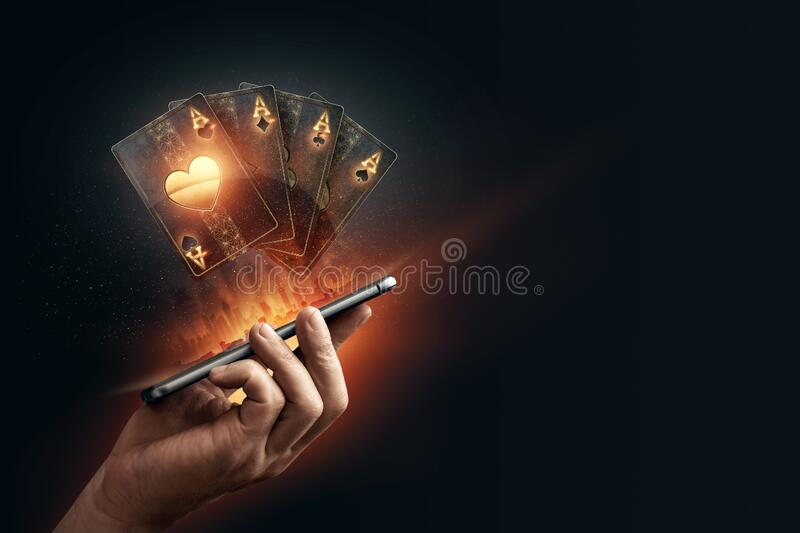 In The Hands Of A Smartphone With Playing Cards, Black-gold Background.  Concept Of Online Gambling, Online Casino. Copy Space Stock Image - Image  of leisure, green: 197363095