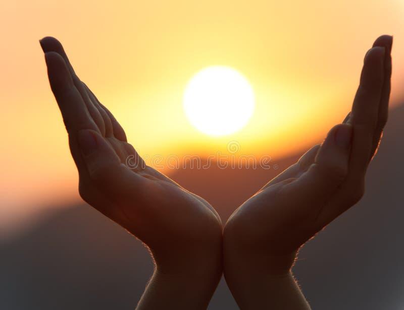 hands solnedgång royaltyfria foton