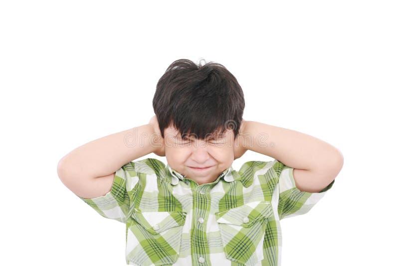 hands stängande öraögon för pojke hans fotografering för bildbyråer