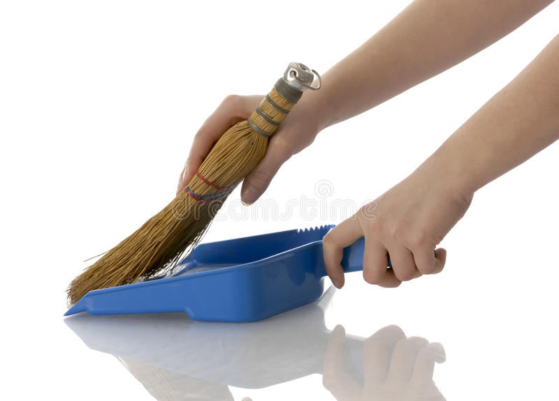 Hands sweeping up stock photos