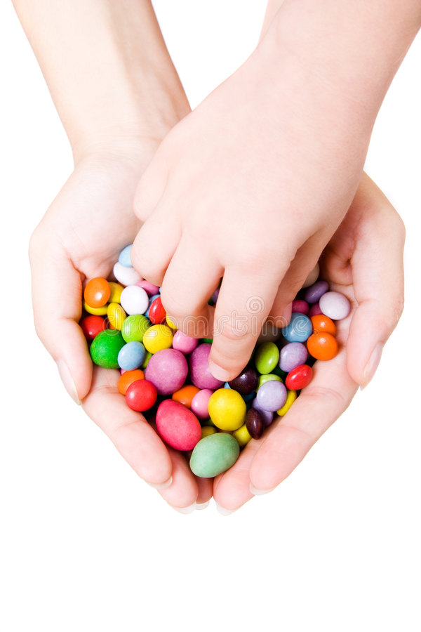 Hands with sweets royalty free stock photos