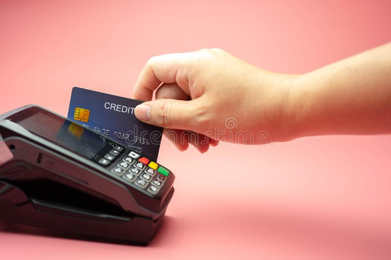 Hands swiping Credit card on Credit card machine or Credit card Terminal, Finance concept.  royalty free stock images