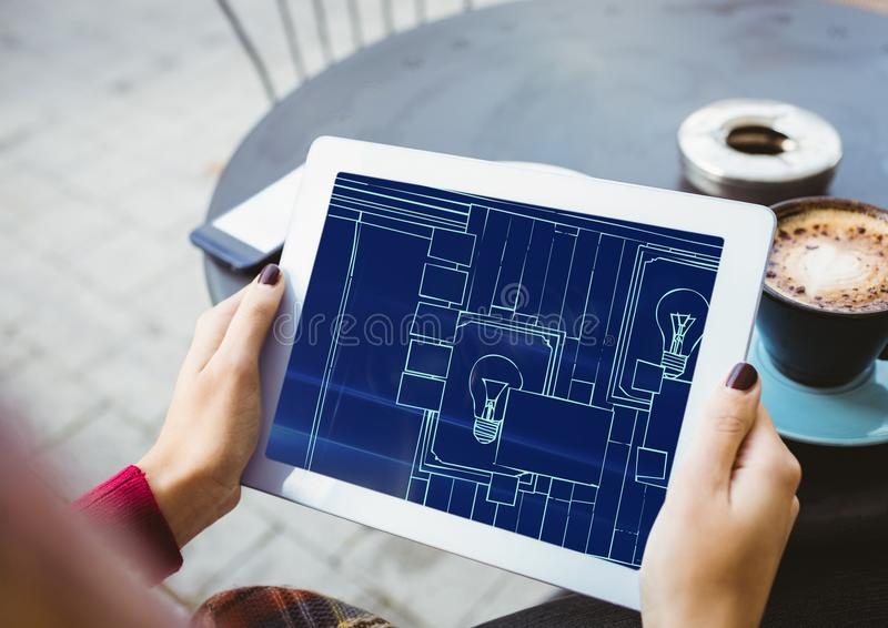 hands with tablet with blueprint on it (two-tone: dark blue and light blue) royalty free illustration