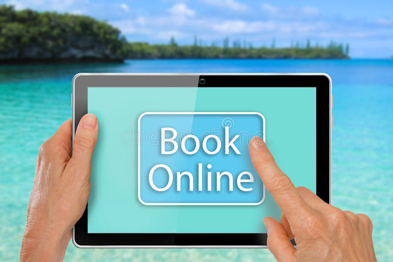 Hands with Tablet Book Vacation Online. Hands with Computer Tablet using Travel App to Book Overseas Vacation Online royalty free stock images