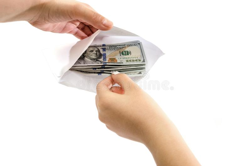 Hands take dollars from a white envelope isolated on a white background. View from above. Hands take dollars from a white envelope isolated on a white stock photos