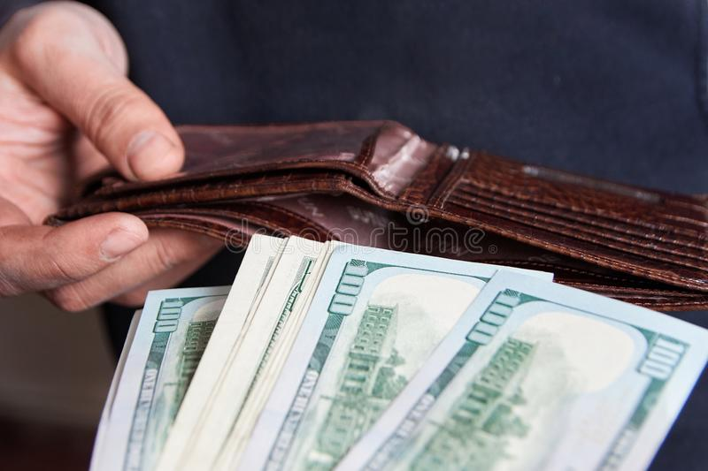 Hands taking out money from wallet Concept of savings, salary, payment and funds stock images