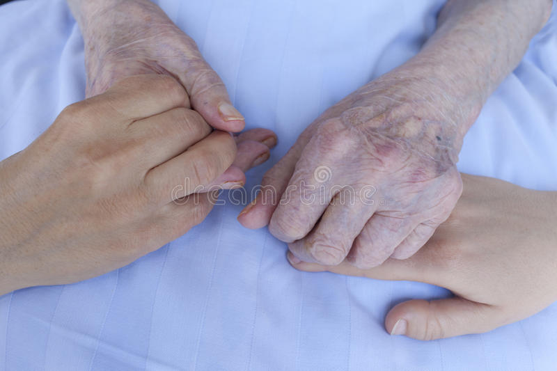 Hands of three generations stock images