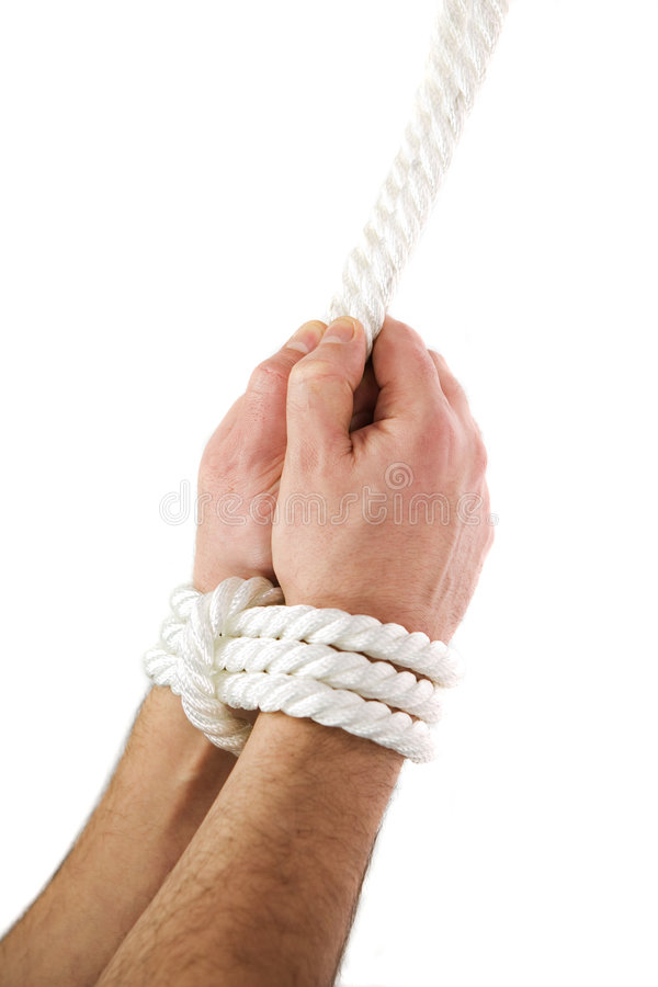 Hands tied. Man hands tied of white rope. Subject isolated on white background. Conceptual image stock image