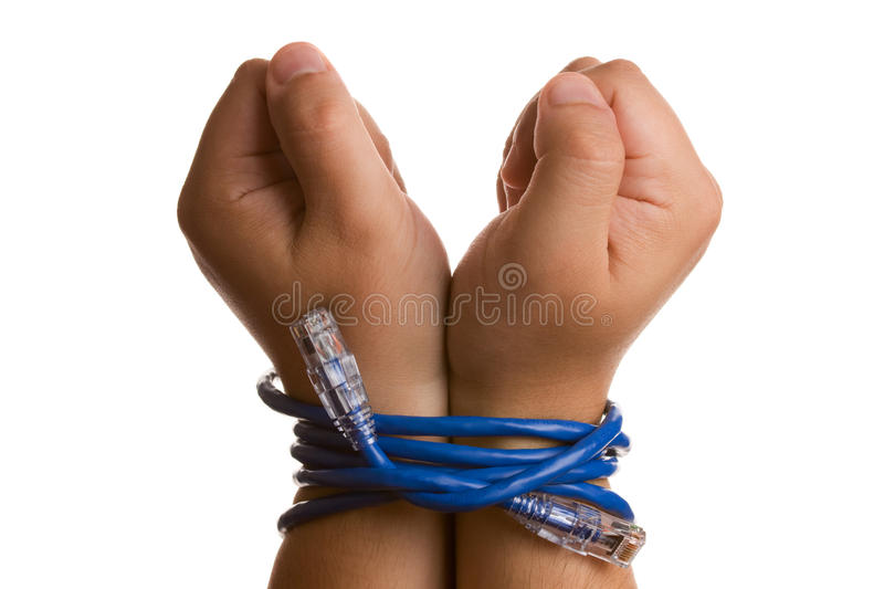 Hands tied with network cable. Studio shot isolated on white. Concept of being tied up by technology royalty free stock photos